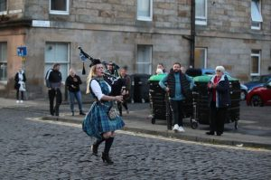 A bagpiper joining the Clap for Carers in Edinburgh. Source: expressandstar.com